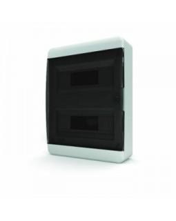 Бокс настенного монтажа 24мод. белый с прозрачной черной дверью и шинами IP40 (Россия)