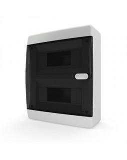 Бокс настенного монтажа 18мод. белый с прозрачной черной дверью и шинами IP40 (Россия)